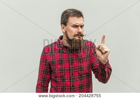 Warning Sign. Young Adult Businessman With Beard And Handlebar Mustache Looking At Camera With Serio