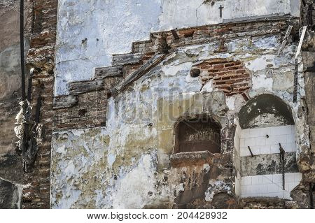 Neglected old and abandoned buildings wall as a background