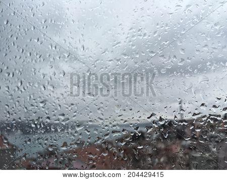 Rain Drops On Window Against City Wiev