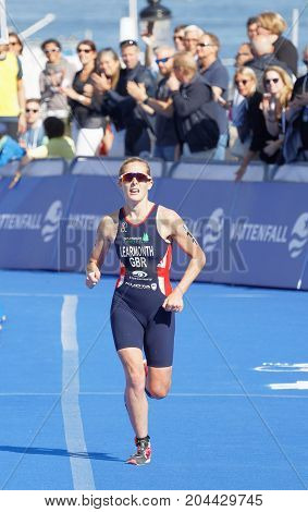 STOCKHOLM - AUG 26 2017: Female triathlete Ashleigh Gentle running at the finish in the Women's ITU World Triathlon series event August 26 2017 in Stockholm Sweden