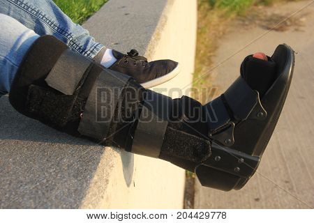 A woman with a walking cast boot