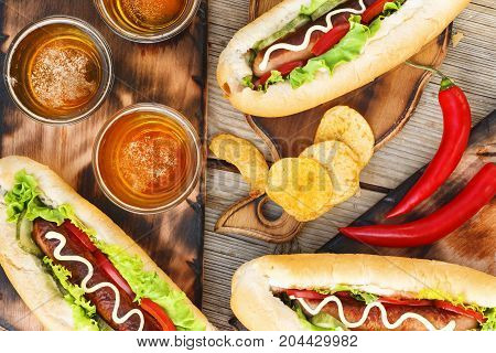 Hotdogs, Chips And Kraft Beer, Top View.