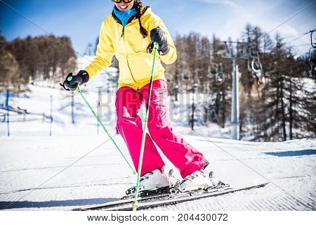 Woman skiing on ski track during winter holidays