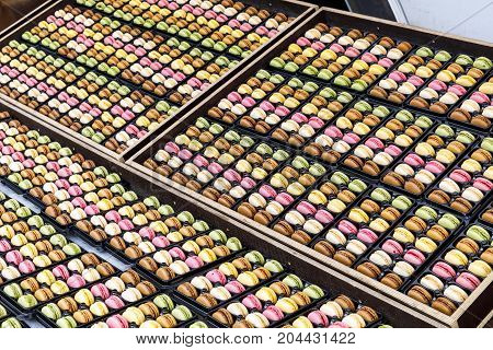 Many tasty colorful sweets exhibited on a table
