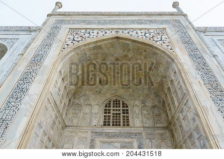 Beautiful marble arch with designs, carvings and windows. These arches on the side of the Taj Mahal add to the majesty of the place