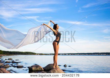 Beautiful Woman In Bikini With White Scarf On The Beach