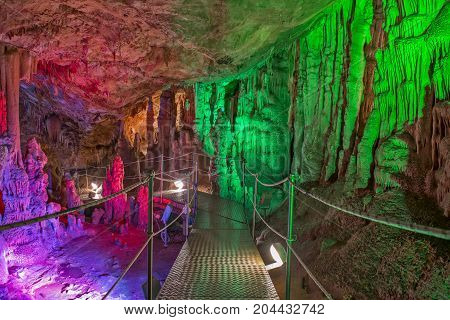 Sfendoni or Zoniana cave on Crete with colorful illumination