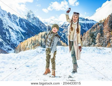 Mother And Daughter Travellers Playing Snowballs
