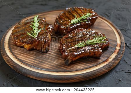 Grilled T-bone Steaks On Stone Table. Top View With Copy Space