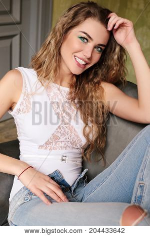 Gorgeous Girl With Blond Curly Hair In Jeans