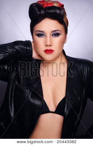 Beautiful sexy asian girl with rockabilly style hairdo and fancy make-up poster