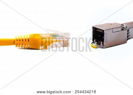 Сable head into (head rj45) of an ethernet wire cable or yellow patch-cord with twisted pair and SFP modulenetworkRJ45plug. Isolated. Close-up