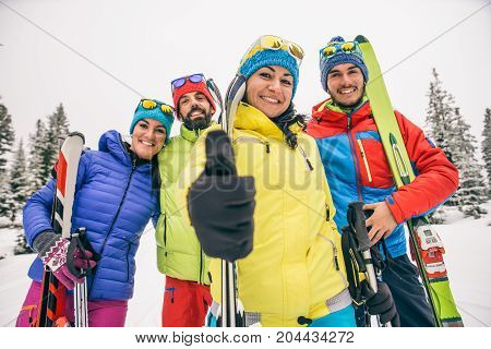Group of friends with ski on winter holidays - Skiers having fun on the snow