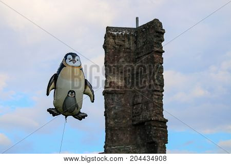 MAGDEBURG, GERMANY - September 16, 2017: A penguin (balloon) floats beside a climbing rock in the air.