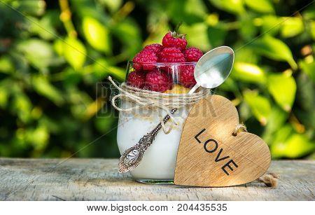 Raspberries homemade yogurt and muesli. Useful breakfast. Romantic breakfast.