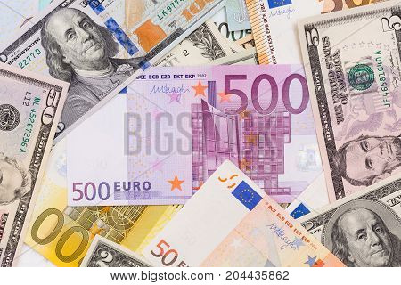 Lot of dollars and euros. Background and texture. High resolution photo.
