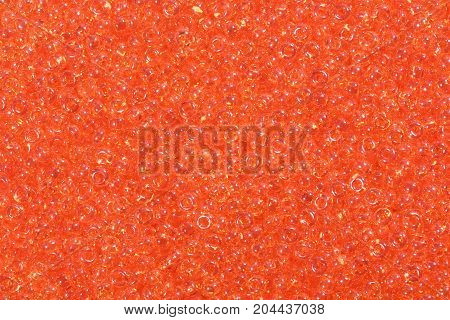 Large amount of orange seed beads. High resolution photo.