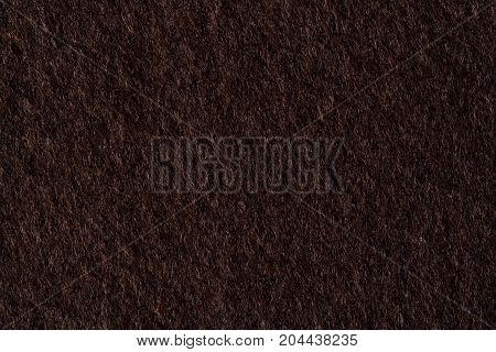 Dark felt texture. High resolution photo of felt.