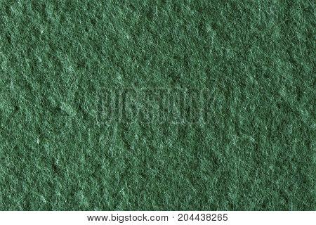 Macro shot of green felt tissue cloth, closeup texture. High resolution photo.