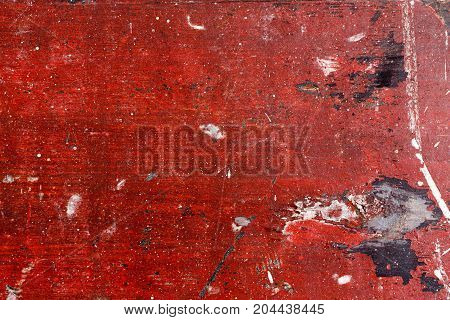 Wood with chipped red paint. Grunge style background. High resolution photo.