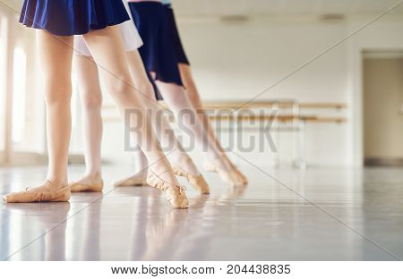 Legs Of Girls In Pointe Practicing In Ballet