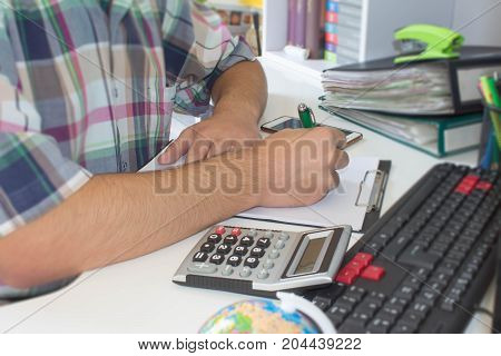 Hands of accountant Businessman with calculator and pen. Business male Analyzing Statistics Financial business Concept