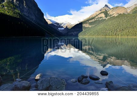 Beautiful High Mountains Of The Canadian Rockies As Seen From Lake Louise Reflecting In An Alpine La