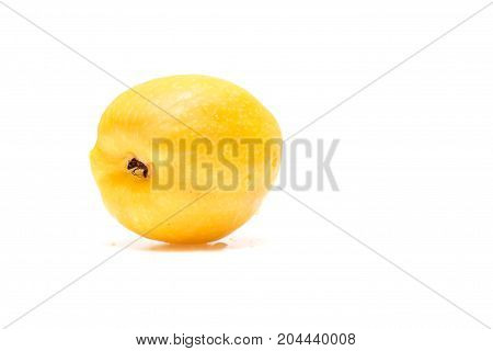 fruit of quince on a white background similar to lemon