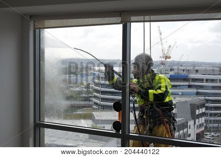 Window Cleaning And Washing Service Worker