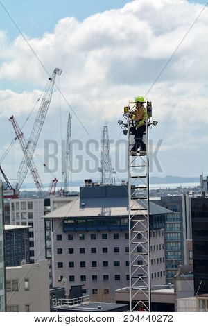 Firefighter On A High Hydraulic Crane Platform