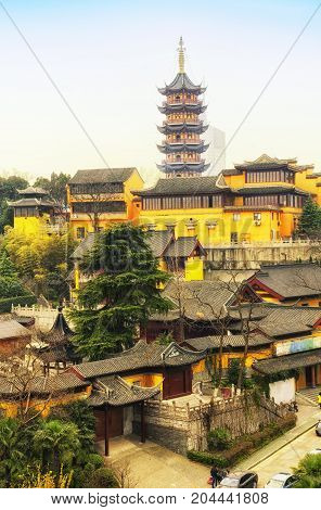 Jiming Temple in the city of Nanjing located in Jiangsu province China on an overcast day.