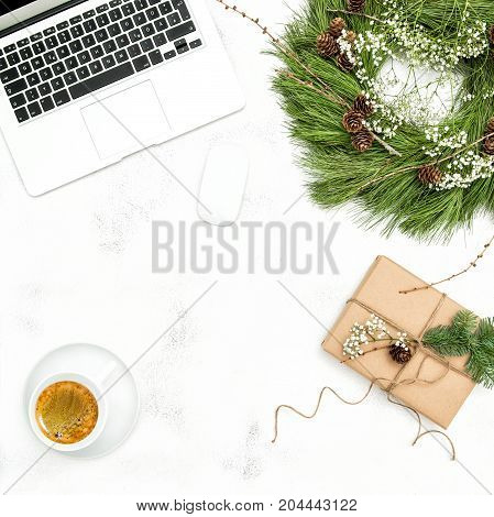 Christmas decoration office working place with coffee and gift. Flat lay