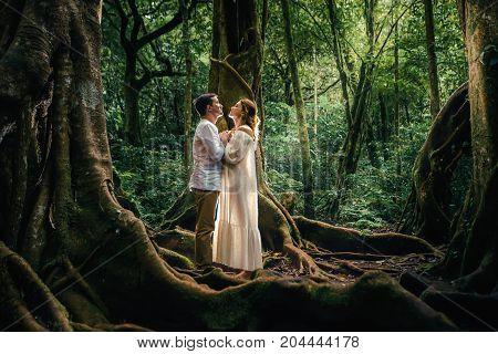 Honeymoon couple at Balinese Botanical Garden in jungle. Ubud, Bali