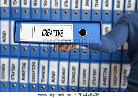 Creative Creativity Ideas Innovation Development Inspire Concept. Young man holding ring binder.