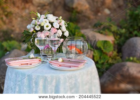 wedding laying table with floristics tender bouquet