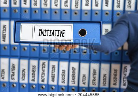 Initiative concept. Young man holding ring binder.