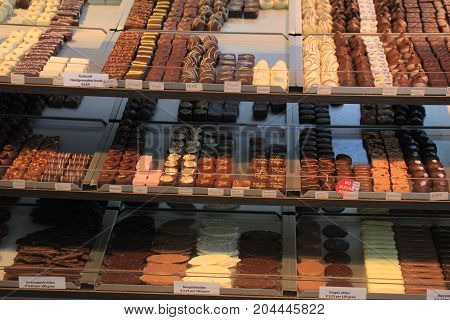 Luxurious Chocolates on display in a confectioner's shop (tags: price and product information in Dutch)