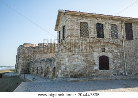 A medieval Larnaca castle and museum at beach waterfront Cyprus