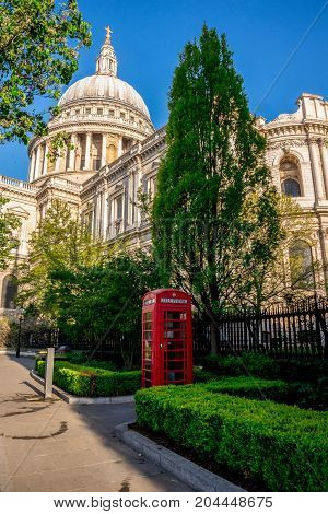 Iconic Red Telephone Booth In St Paul's Cathedral Churchyard In Central London