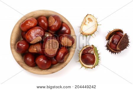 chestnut in a wooden bowl isolated on white background. Top view.