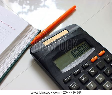 Open blank white notebook with copyspace and pen lying on a white table, top view / for your text or message / view from above
