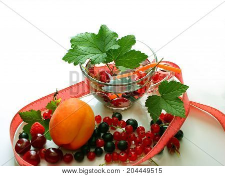 Menu diet plan or program, a glass of cocktail berries, tape measure, dumbbells and diet food fresh fruits on a white background. Weight loss and the concept of detoxification