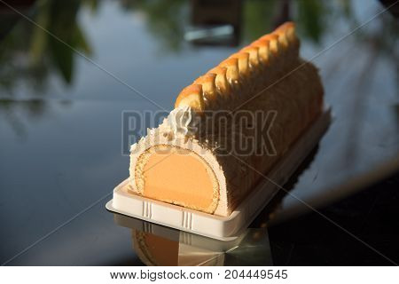 image of a Orange cake with an icecream