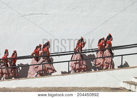 Ronda, Spain - May 3, 2014: Children dancers going to the stage during Corpus Christi Procession festival in Ronda, Spain