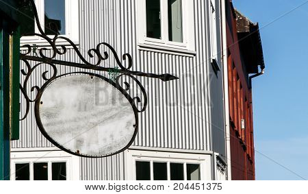 Generic ornate oblong sign mounted to a wall. Insert your own custom text.