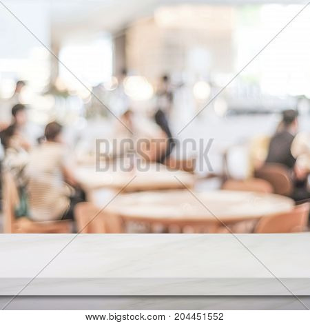 Empty white marble table over blur restaurant background product and food display montage