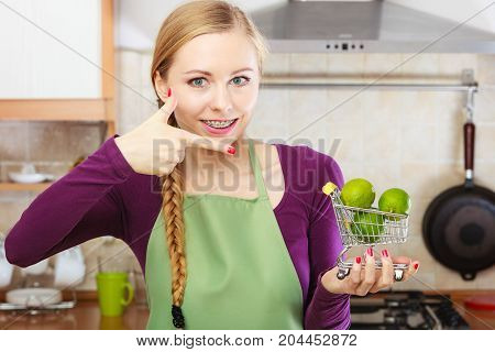 Woman Holding Shopping Cart With Limesinside