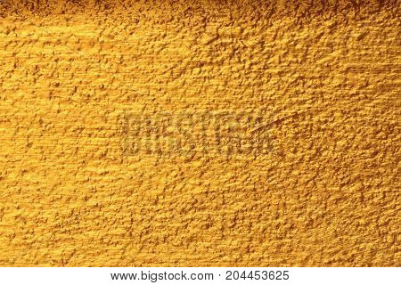 Dark gold texture, uneven texture for the background.