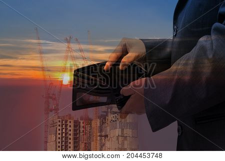 Business people check black wallet on building backgroundbusiness concept
