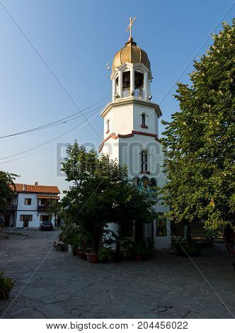 POMORIE BULGARIA - AUGUST 18 2017: Orthodox monastery of St. George. The bell tower above the Sacred source of water.